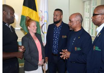 (From left) Dwayne Barrett, President of the Jamaica Judo Association,  and General Secretary Szandra Szogedi, share with Jamaica Olympic Association officials Ryan Foster (CEO), Christopher Samuda, President and Director Laurel Smith, upon their return from India where judoka Tom Davis won two gold medals at the Commonwealth Games Judo Championship.