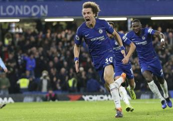 Chelsea's David Luiz, left, celebrates after scoring his side's opening goal during the English Premier League football match against Manchester City at Stamford Bridge in London, Saturday Dec. 8, 2018.