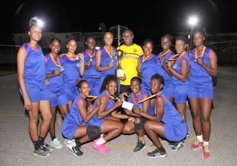 Mayor Leon Thomas (back row, centre) poses with members of the Queens Park netball team who won the inaugural Mayor Leon Thomas Portmore Sunshine City Netball League recently.