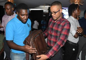 Jason McNeish (right) , marketing manager, The Jamaica National Group examines one of the bags produced by Bresheh with Randy McLaren, co-founder & managing director of Bresheh at the official launch of Bresheh's new collections of bags in September.
