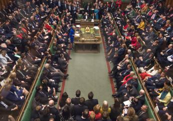 Britain's Prime Minister Theresa May, centre left, speaks in the House of Commons, after MPs rejected a no-confidence vote against the government, in London, Wednesday Jan. 16, 2019.   (Mark Duffy, UK Parliament via AP)