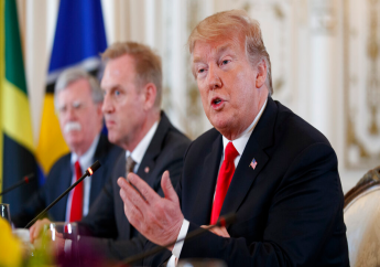 From left, National Security Adviser John Bolton, Acting Defense Secretary Patrick Shanahan, and President Donald Trump sit together during a meeting with Caribbean leaders at Mar-A Lago, Friday, March 22, 2019, in Palm Beach, Fla. (AP Photo/Carolyn Kaster)