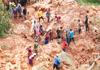 A family dig for their son who got buried in the mud when Cyclone Idai struck in Chimanimani about 600 kilometres south east of Harare, Zimbabwe, Tuesday, March, 19, 2019. (AP Photo/Tsvangirayi Mukwazhi)
