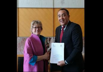 Photo: Health and Wellness Minister, Dr. Christopher Tufton and Chief Medical Officer of the UK and Northern Ireland, Professor Sally Davies exchange copies of the signed MOU for the Nurses Training Programme.