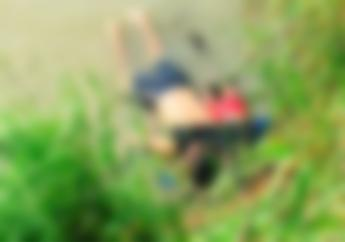 EDS NOTE: GRAPHIC CONTENT - The bodies of Salvadoran migrant Oscar Alberto Martínez Ramírez and his nearly 2-year-old daughter Valeria lie on the bank of the Rio Grande in Matamoros, Mexico, Monday, June 24, 2019, after they drowned trying to cross the river to Brownsville, Texas. (AP Photo/Julia Le Duc)
