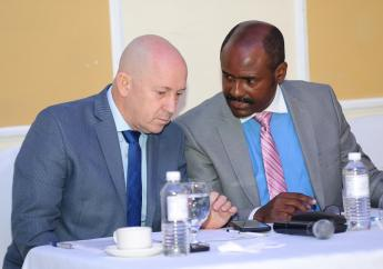Jonathan Wemyss-Gorman Vice Chair of the Jamaica Bankers Association Anti-Fraud Committee shares a word with Dirk Harrison( right), Director of Prosecution, National Integrity Commission.