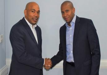 Jerome Smalling (left), newly appointed President, Jamaica Bankers Association shakes hands with outgoing President, David Noel.