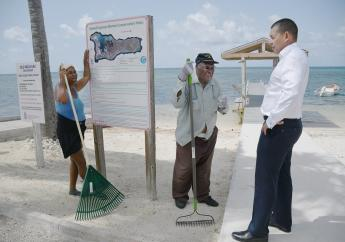 """NiCE workers Nella Stone and Author """"Ranford"""" McLean talk to Minister Hew during his tour of NiCE beautification sites."""