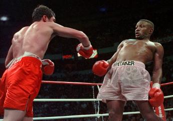 In this April 12, 1997, file photo, Pernell Whitaker, right, leans away from a punch by Oscar De La Hoya during their WBC Welterweight Championship fight at Thomas & Mack Center in Las Vegas. De La Hoya won by unanimous decision. (AP Photo/Eric Draper, File)