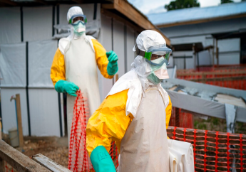 In this photograph taken Saturday July 13, 2019, health workers wearing protective suits take their shift at a treatment center in Beni, Congo DRC. More than 1,600 people in eastern Congo have died as the virus has spread in areas too dangerous for health teams to access.(AP Photo/Jerome Delay)