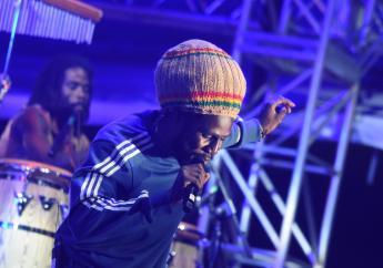 Chronixx skanks on stage during his performance at Reggae Sumfest on Sunday morning. (PHOTOS: Marlon Reid)