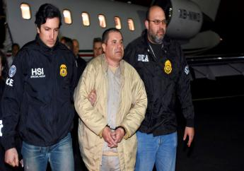 """In this Jan. 19, 2017, file photo provided by U.S. law enforcement, authorities escort Joaquin """"El Chapo"""" Guzman, centre, from a plane to a waiting caravan of SUVs at Long Island MacArthur Airport, in Ronkonkoma, N.Y. (U.S. law enforcement via AP, File)"""
