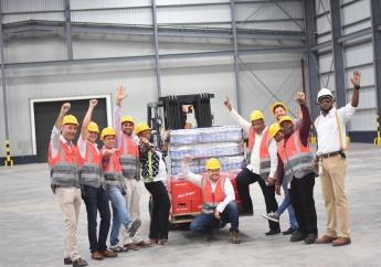 Celebration Brands Limited workers celebrate the opening of the new distribution centre. (PHOTOS: Marlon Reid)