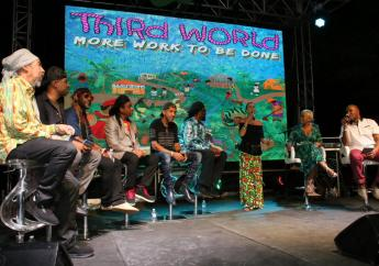 Members of reggae band Third World look on as Cindy Breakspeare (centre), mother of Damian Marley, who produced the group's latest album, 'More Work To Be Done', speaks at the launch of the project at Bob Marley Museum on Thursday. Also pictured on stage is media personality Debbie Bissoon, who served as emcee.