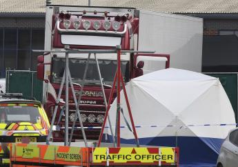 View of a truck, seen in rear, that was found to contain a large number of dead bodies, in Thurrock, South England, early October 23, 2019. Police in southeastern England said that 39 people were found dead Wednesday inside the truck container believed to have come from Bulgaria. (Stefan Rousseau/PA via AP)