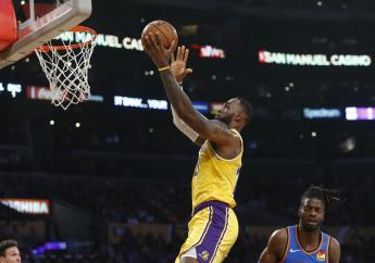 Los Angeles Lakers' LeBron James (23) goes up to the basket against the Oklahoma City Thunder during the first half of an NBA basketball game, Tuesday, Nov. 19, 2019, in Los Angeles. (AP Photo/Ringo H.W. Chiu).