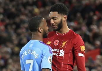 Liverpool's Joe Gomez, right, and Manchester City's Raheem Sterling clash during the Premier League soccer match at Anfield, Liverpool, Sunday November 10, 2019. (Photo: AP)