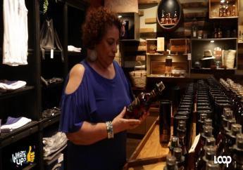 Joy Spence examines one her products.