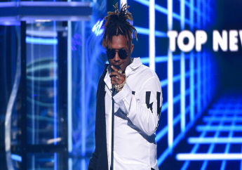 PreviousNext FILE - In this May 1, 2019 file photo, Juice WRLD accepts the award for top new artist at the Billboard Music Awards at the MGM Grand Garden Arena in Las Vegas. (Photo by Chris Pizzello/Invision/AP, File)