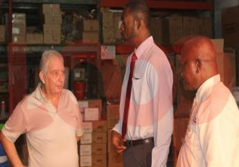 Robert Mansour (left) speaking with Minister Jordan (center) and Chief Labour Office, Victor Felix (right).