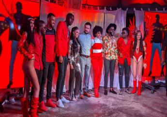 Flanked by the Digicel girls,  (L-R) Aaron 'Voice' St Louis, Jerome 'Rome' Priscilla, Nesta 'Sekon Sta' Boxill, Vanessa 'Nessa Preppy' John, Digicel T&T CEO Jabbor Kayumov, Nailah Blackman, Marvin 'Swappi' Davis and Akeem 'Preedy' Chance pose for photographs.