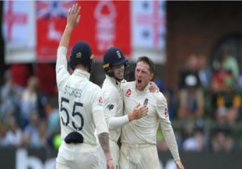 Dom Bess (right) celebrates taking a wicket for England against South Africa.