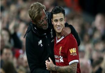 Liverpool boss Jurgen Klopp (left) and  Philippe Coutinho.