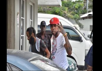 In this file photo, Vybz Kartel flashes his trademark 'Gaza' hand symbol before entering court.