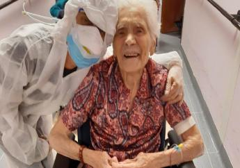 """In this photo taken on April 1, 2020, 103-year-old Ada Zanusso, poses with a nurse at the old people's home """"Maria Grazia"""" in Lessona, northern Italy, after recovering from Covid-19 infection. To recover from coronavirus infection, as she did, Zanusso recommends courage and faith, the same qualities that have served her well in her nearly 104 years on Earth. (Residenza Maria Grazia Lessona via AP Photo)"""