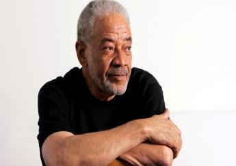 """n this June 21, 2006 file photo, singer-songwriter Bill Withers poses in his office in Beverly Hills, Calif. Withers, who wrote and sang a string of soulful songs in the 1970s that have stood the test of time, including """"Lean On Me,"""" """"Lovely Day"""" and """"Ain't No Sunshine,"""" died in Los Angeles from heart complications on Monday, March 30, 2020. He was 81. (AP Photo/Reed Saxon, File)"""