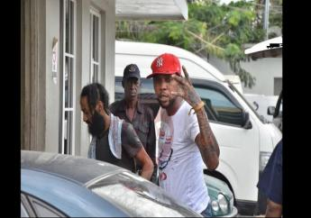 In this Loop News file photo, entertainer Vybz Kartel makes a hand gesture ahead of an appearance in a Corporate Area court.