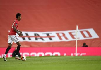 Manchester United's Marcus Rashford takes the ball up field during the English Premier League footall match against Southampton at Old Trafford in Manchester, England, Monday, July 13, 2020. (AP Photo/Dave Thompson,Pool).