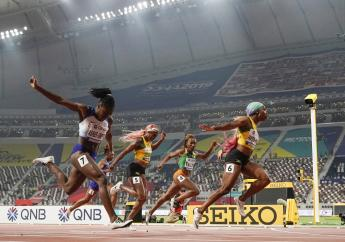 Shelly-Ann Fraser-Pryce, of Jamaica, wins the women's 100m finals at the World Athletics Championships in Doha, Qatar, Sunday, Sept. 29, 2019. (AP Photo/Morry Gash).