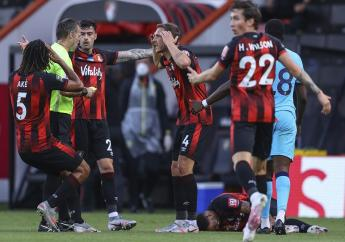 Bournemouth players argue with the referee during the English Premier League footall match against Tottenham at the Vitality Stadium in Bournemouth, England, Thursday, July 9, 2020. (Richard Heathcote/Pool via AP).