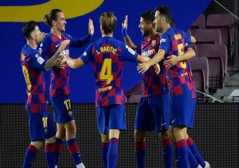 Le FC Barcelone est revenu à un point du Real Madrid, dans un derby où l'Espanyol Barcelone a dit adieu à ses dernières chances de maintien.   AFP