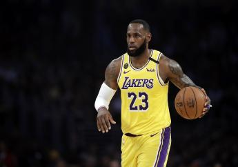 In this March 10, 2020, file photo, Los Angeles Lakers' LeBron James (23) dribbles during the first half of an NBA basketball game against the Brooklyn Nets in Los Angeles.  (AP Photo/Marcio Jose Sanchez, File).