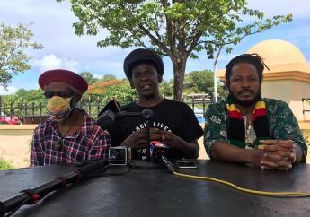 Interim Chairman of Black Lives Matter St Lucia, Peter 'Ras' Ipa Isaac (centre), ICAR president, Aaron Alexander (right)