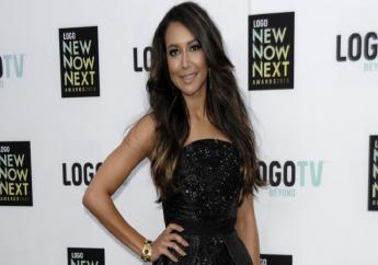 """FILE - Actress Naya Rivera arrives at Logo's NewNowNext Awards in Los Angeles on April 13, 2013. Authorities say former """"Glee"""" star Naya Rivera is missing and being searched for at a Southern California lake. Rivera played Santana, a cheerleader in the musical-comedy """"Glee"""" that aired on Fox from 2009 until 2015. (Photo by Dan Steinberg/Invision/AP, File)"""