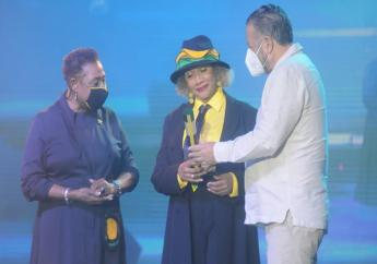 'Queen of Reggae' Marcia Griffiths (centre) being honoured for her contribution to Jamaican music at the Jamaica58 Independence Spectacular on Thursday. Culture Minister Olivia Grange and Government Senator Tom Tavares Finson share in the occasion.
