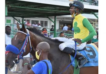 FATHER PATRICK, with former six-time champion jockey Omar Walker, poses in the winner's enclosure after winning the Betting, Gaming and Lotteries Commission Trophy, over five and a half furlongs, at Caymanas Park on Saturday, August 1, 2020. (PHOTO: caymanasracing.com).