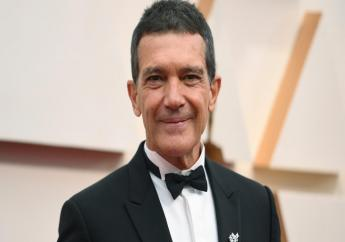 Antonio Banderas arrives at the Oscars in Los Angeles on Feb. 9, 2020. Banderas says he's tested positive for COVID-19 and is celebrating his 60th birthday in quarantine. The Spanish actor announced his positive test on Instagram on Monday. (Photo by Richard Shotwell/Invision/AP, File)