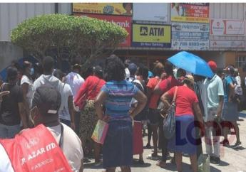 Long lines at remittance agent locations in Jamaica