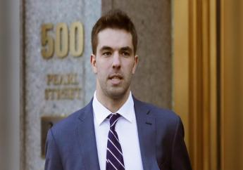 """In this March 6, 2018 file photo, Billy McFarland, the promoter of the failed Fyre Festival in the Bahamas, leaves federal court after pleading guilty to wire fraud charges in New York. More than three years after the highly publicized Fyre Festival famously fizzled out in the Bahamas, merchandise and other """"minor assets"""" are available for purchase, courtesy the U.S. Marshals Service from Texas-based Gaston & Sheehan Auctioneers. (AP Photo/Mark Lennihan, File)"""