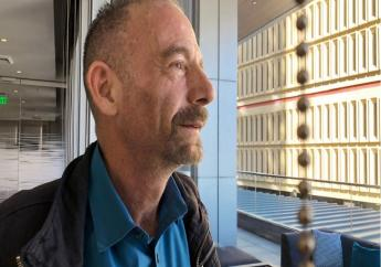 """FILE - This March 4, 2019 file photo shows Timothy Ray Brown in Seattle. Brown, who made history as """"the Berlin patient,"""" the first person known to be cured of HIV infection, died Tuesday, Sept. 29, 2020, at his home in Palm Springs, Calif., according to a social media post by his partner, Tim Hoeffgen. He was 54.  (AP Photo/Manuel Valdes, File)"""