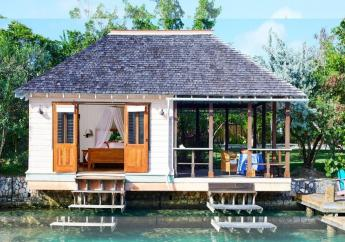 Lagoon Cottages have king size beds positioned to face the lagoon and Santa Maria Island, the small, uninhabited piece of land at the lagoon's center. (Photos: GoldenEye)