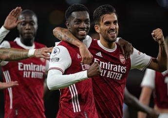 Arsenal's Eddie Nketiah, centre, celebrates scoring his side's second goal during the English Premier League football match against West Ham at the Emirates Stadium in London, England, Saturday, Sept. 19, 2020. (Will Oliver/Pool via AP).