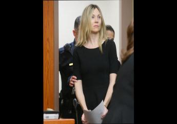 In this Feb. 14, 2013, file photo, Amy Locane enters the courtroom to be sentenced in Somerville, New Jersey.  (Patti Sapone/NJ Advance Media via AP, Pool, File