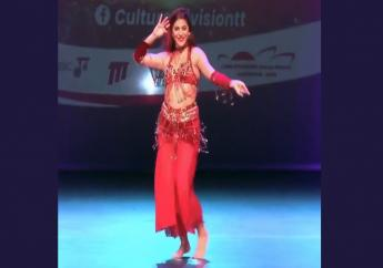 Rebecca Elias Griffith during her belly dancing performance at the Culture Division's Colours of Consciousness Concert on Friday, September 18.