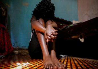 A teenage girl who became a sex worker after schools in Kenya were closed in March due to coronavirus restrictions, sits in the rented room where she and others work, in Nairobi, Kenya Thursday, October 1, 2020. The girls saw their mothers' sources of income vanish when Kenya's government restricted movement to prevent the spread of the virus, and now engage in the sex work to help with household bills. (AP Photo/Brian Inganga)