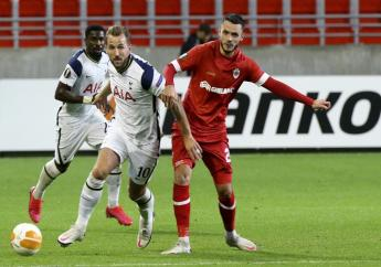 Tottenham's Harry Kane, centre, vies for the ball against Royal Antwerp's Jeremy Gelin during their Europa League Group J football match at the Bosuil stadium in Antwerp, Belgium, Thursday, Oct. 29, 2020. (AP Photo/Francois Walschaerts).